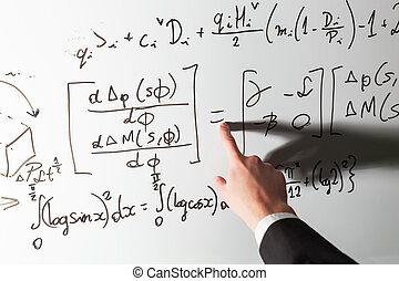 Teacher pointing finger on equality math symbol on whiteboard. Mathematics and science