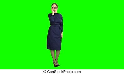 Teacher posing and adjusting glasses. Green screen - Teacher...