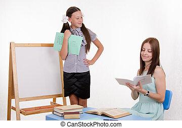 Teacher puts exellent student - Pupil stands at the...