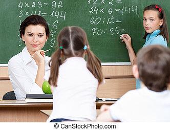 Teacher questions pupils at mathematics - Smart teacher...