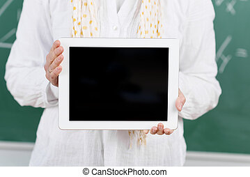 Teacher showing a tablet for her classroom