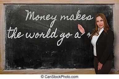 Teacher showing Money makes the world go around on...