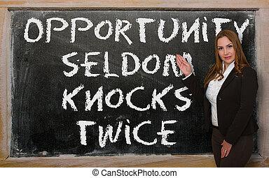 Teacher showing Opportunity seldom knocks twice on...