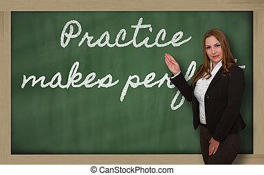 Teacher showing Practice makes perfect on blackboard