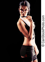 teacher - Sexy young woman posing over black background.