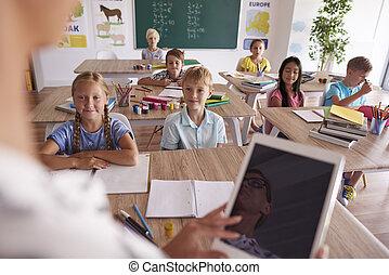 Teacher teaching from digital tablet