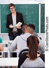Teacher Teaching Mathematics To Students