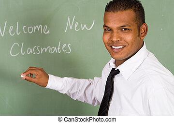 indian teacher writing on the board