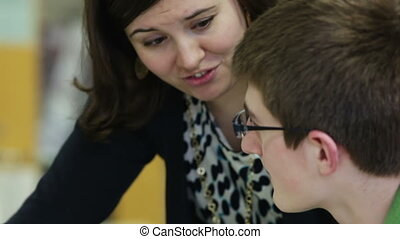 Teacher tutoring student - High school teacher tutoring a...