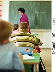 Teacher walking in classroom
