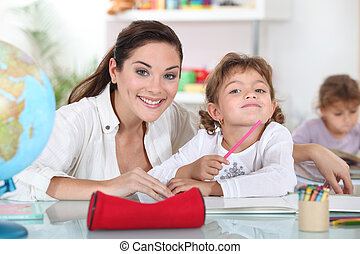 Teacher with a little girl