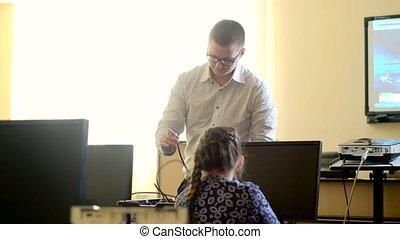 Teacher with computer takes a math class 4k