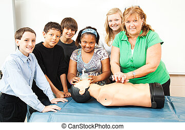 Teacher with CPR Class and Dummy