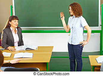 Teacher with student in classroom