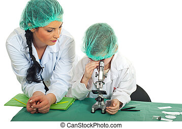 Teacher with student in laboratory