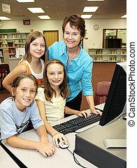 Teacher With Students - A helpful teacher instructing her ...