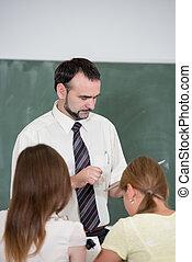 teacher with students in auditorium