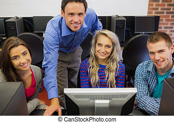Teacher with students in computer room