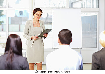Teacher with students on seminar