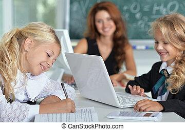 teacher with two girls in school