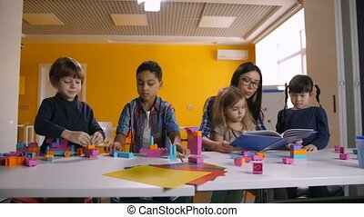 Teacher working with children in preschool class