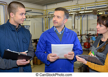 teachers and students checking machinery procedure