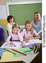 Teachers and students in classroom - Back to school -...