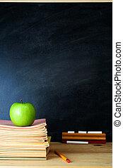 Teacher's Desk and Chalkboard - A school chalkboard and...
