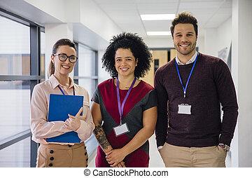 Teachers In The Hallway - Portrait of three teachers in the...