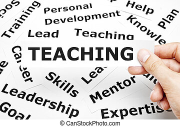 Teaching Concept - Hand holding a piece of paper with...