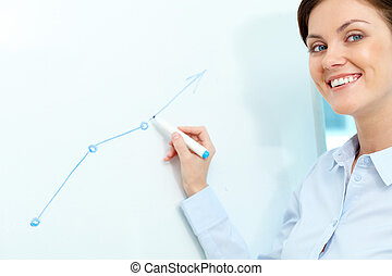 Teaching - Portrait of a lovely young businesswoman looking...