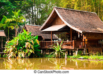 Teak house  poolside in thailand