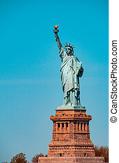 Teal and orange view of the statue of Liberty in New York City