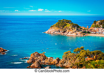 Teal and orange view of Tossa de Mar village and Castle.