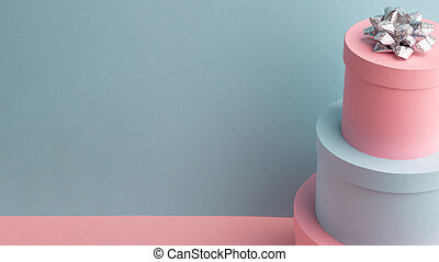 Teal and pink round gift boxes with cute silver bow on top