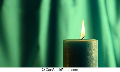 Teal candle trembling flame with gr
