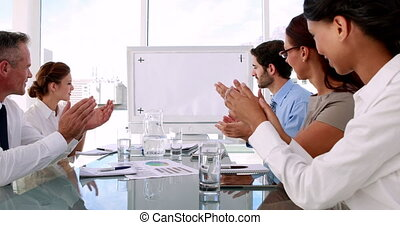 Team applauding a copy space - Business team applauding a...
