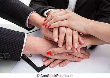 Team being united - Hands of team members expressing unity