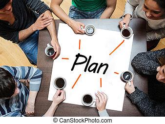 Team brainstorming over a poster wi - Team brainstorming...