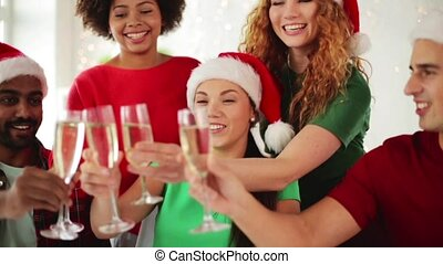 team celebrating christmas at office party - christmas,...