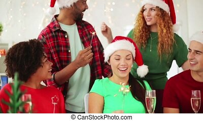 team celebrating christmas at office party