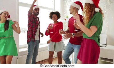 team dancing at christmas corporate office party -...