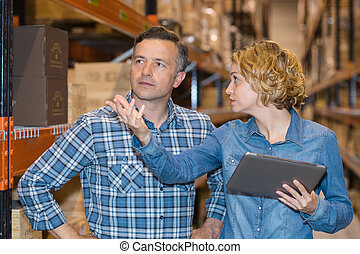 team discussing while working in warehouse