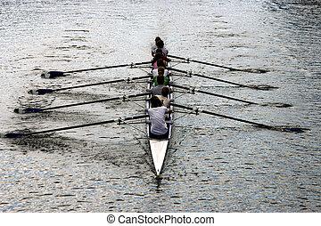 Women rowers oar on river