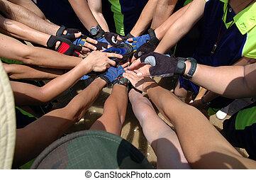 Team hands together - Team holding hands together on a sport...