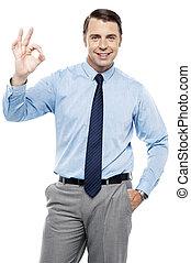 Team leader gesturing okay sign to his subordinates