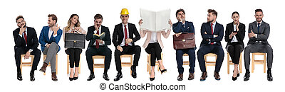 Team of 10 businessmen waiting for a job interview