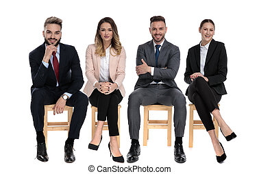 Team of 4 positive businessmen smiling while sitting