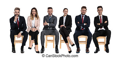 6 positive businessmen smiling and looking forward while sitting
