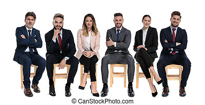 Team of 6 positive businessmen smiling and looking forward